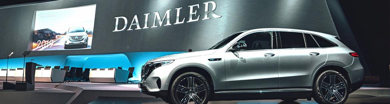 Daimler posts rebound in profit, raises outlook