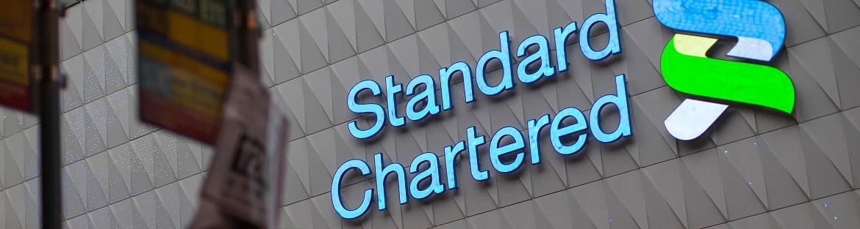 Standard Chartered restores buybacks, returns to dividend