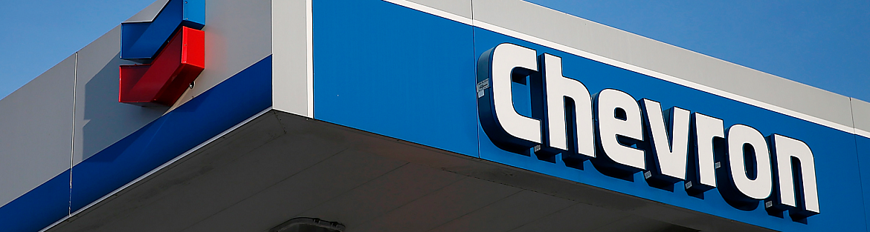 Chevron pledges to deliver higher returns and cut carbon emissions